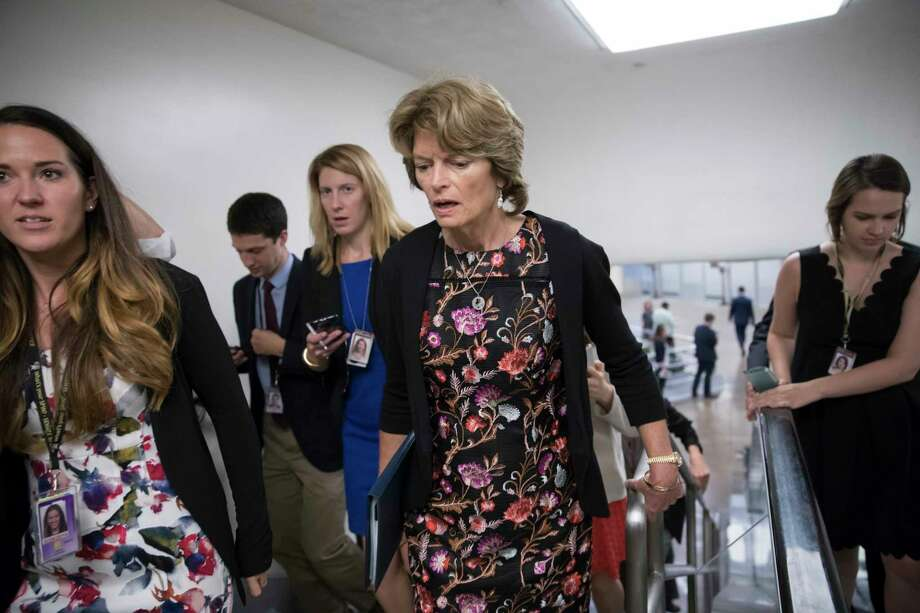 In this Sept. 19, 2017, photo, Sen. Lisa Murkowski, R-Alaska, speaks with a reporter as she arrives for a vote at the Capitol in Washington. Provisions shoehorned into the Republican health care bill dangle extra money for Alaska and Wisconsin, home states of one GOP senator whose vote party leaders desperately need and another who co-sponsored the legislation, according to analysts who've studied the legislation. (AP Photo/J. Scott Applewhite) Photo: J. Scott Applewhite, STF / Copyright 2017 The Associated Press. All rights reserved.