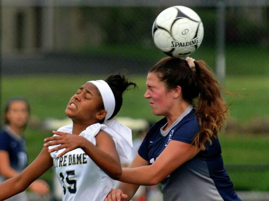 Notre Dame of Fairfield's Daryn Dickson, left, and Immaculate's Adi Chamberlin head the ball during Class M girls soccer action in Fairfield, Conn., on Thursday Sept. 21, 2016. Photo: Christian Abraham / Hearst Connecticut Media / Connecticut Post