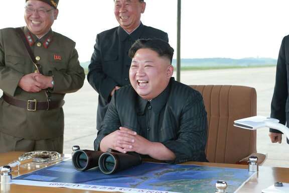 North Korean leader Kim Jong Un, center, attends what was said to be the test launch of an intermediate range Hwasong-12 missile at an undisclosed location in North Korea. (Korean Central News Agency/Korea News Service via AP, File)