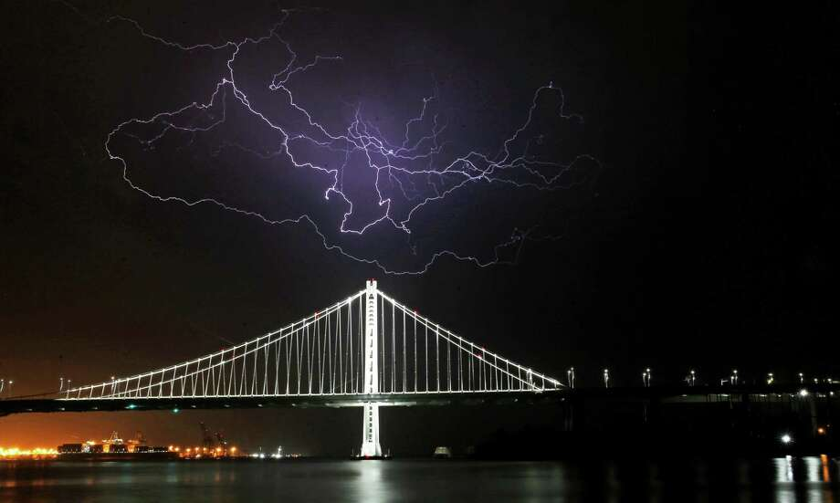 Lighting strikes above the eastern span of the San Francisco -Oakland Bay Bridge on September 11, 2017 in San Francisco. Photo: Michael Macor / The Chronicle / ONLINE_YES