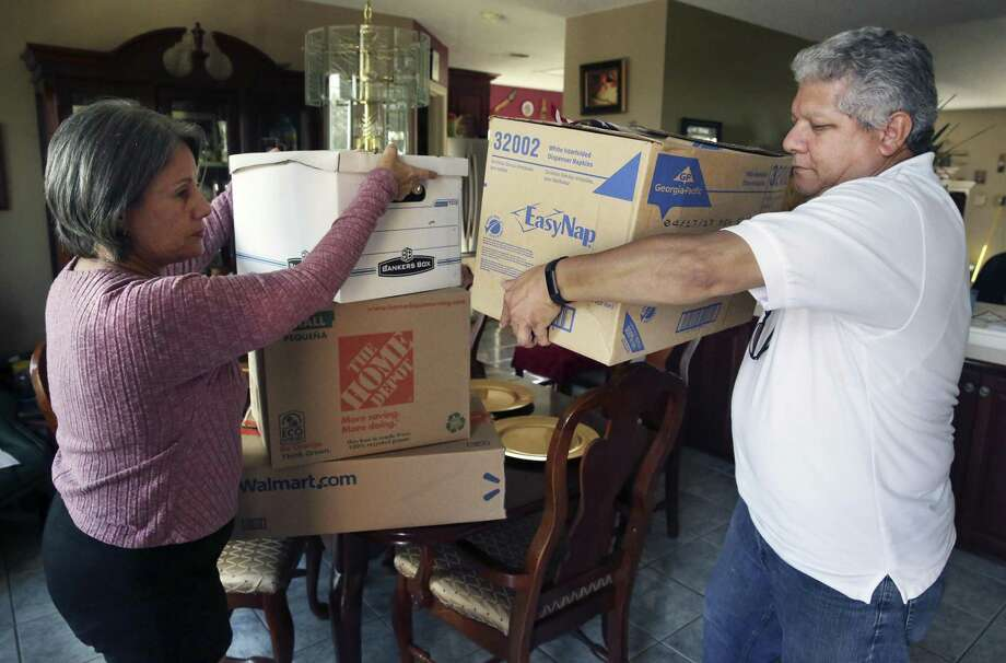 Migdalia and Daniel Aponte, president and vice president of the Association of Puerto Ricans in San Antonio, gather goods Thursday for a relief effort for Puerto Rico in the aftermath of Hurricane Maria. Photo: Tom Reel /San Antonio Express-News / 2017 SAN ANTONIO EXPRESS-NEWS