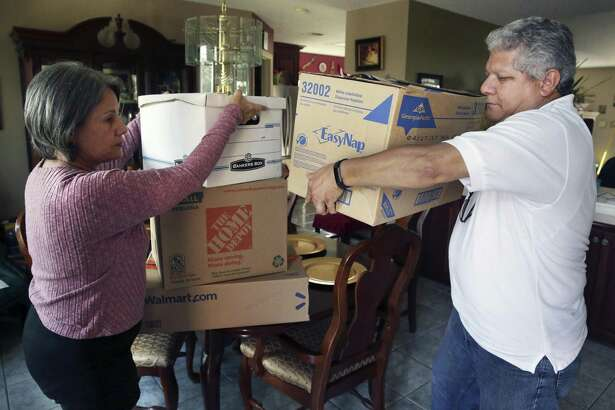 Migdalia and Daniel Aponte, president and vice president of the Association of Puerto Ricans in San Antonio, gather goods Thursday for a relief effort for Puerto Rico in the aftermath of Hurricane Maria.