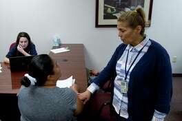 Marita Sims, a disaster relief coordinator with FEMA, talks with a Spanish-speaking client as FEMA and the Small Business Association disaster assistance program set up offices for clients at the former Conroe Police Department, Thursday, Sept. 21, 2017, in Conroe.