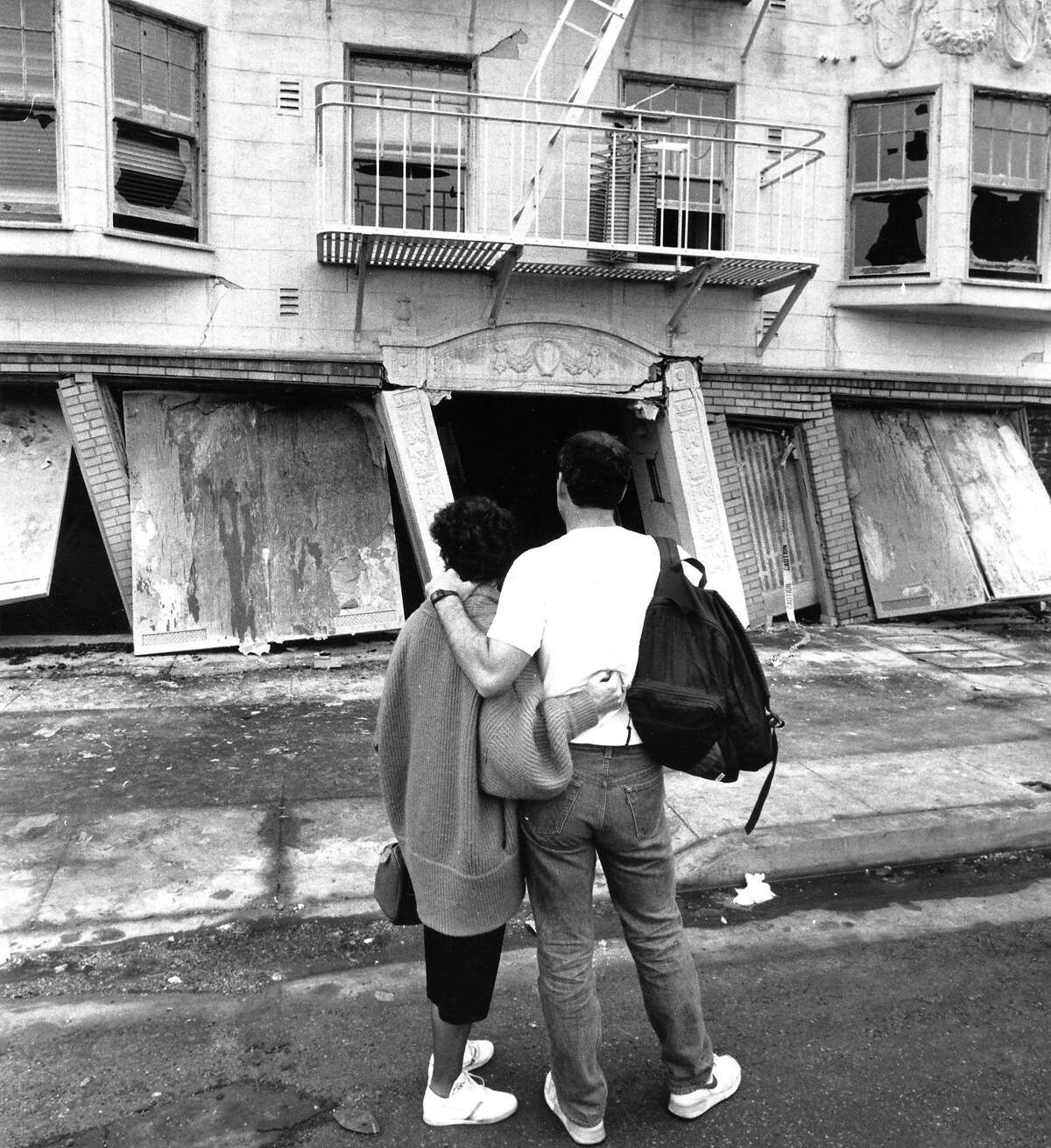 Two residents stand in front of their former apartment building in the Marina district after the Loma Prieta earthquake October 18, 1989 Photo ran 10/17/1990 P. B3