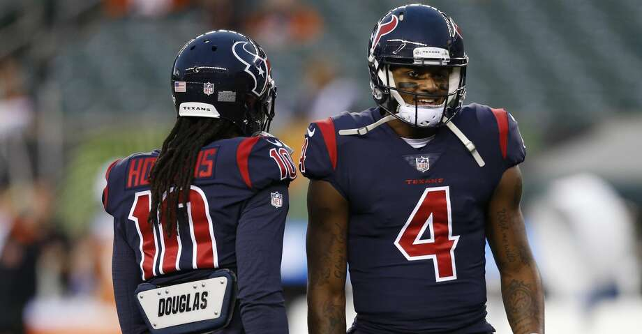 PHOTOS: Texans 13, Bengals 9Houston Texans quarterback Deshaun Watson (4) meets with wide receiver DeAndre Hopkins (10) during practice before an NFL football game against the Cincinnati Bengals, Thursday, Sept. 14, 2017, in Cincinnati. (AP Photo/Gary Landers)Browse through the photos to see action from the Texans' Week 2 win over the Bengals. Photo: Gary Landers/Associated Press