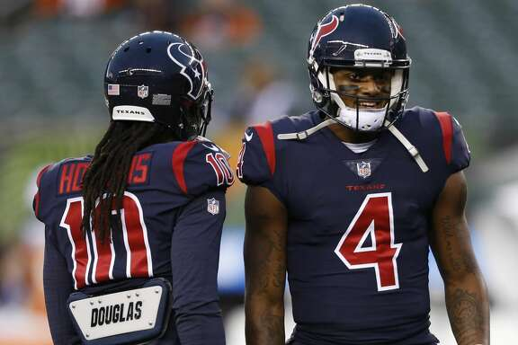 Houston Texans quarterback Deshaun Watson (4) meets with wide receiver DeAndre Hopkins (10) during practice before an NFL football game against the Cincinnati Bengals, Thursday, Sept. 14, 2017, in Cincinnati. (AP Photo/Gary Landers)