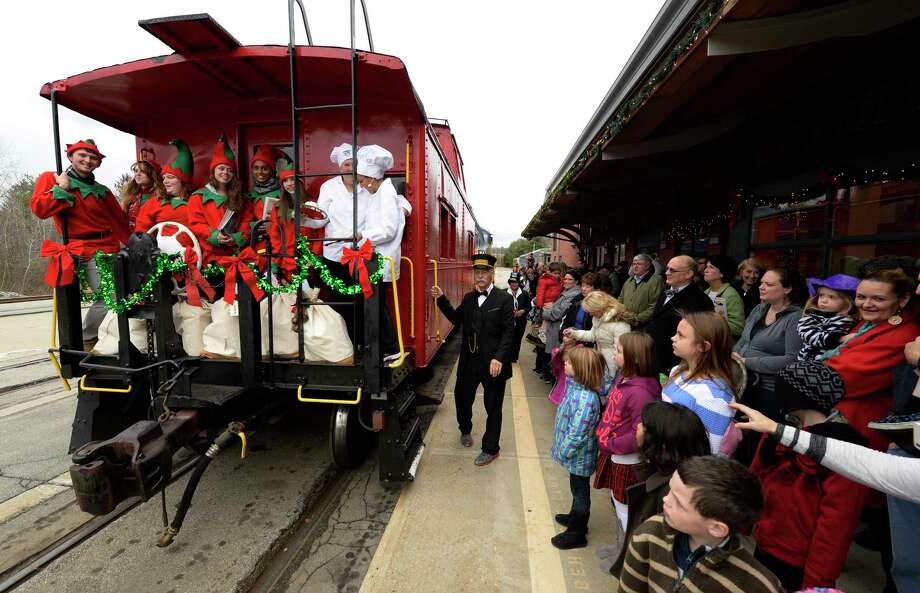 Elves loaded down with letters for Santa board the Mail Car during the kick-off for this years Saratoga & North Creek Railroad's version of the Polar Express Monday afternoon Nov. 11, 2013,  at the Saratoga train station in Saratoga Springs, N.Y.    (Skip Dickstein/Times Union Photo: SKIP DICKSTEIN / 00024558A