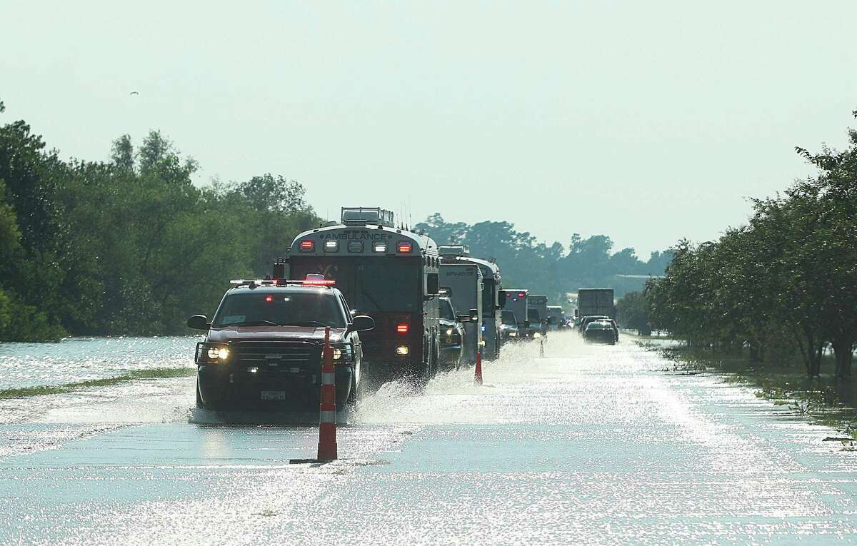 A caravan of ambulances and first responders leaving Houston and Liberty County travel through the flooded waters as they headed for rescue efforts in Beaumont. The record could go even higher - perhaps reaching 60 inches in some areas - as meteorologists continue to analyze the data that literally poured into the Houston region starting Aug. 25.