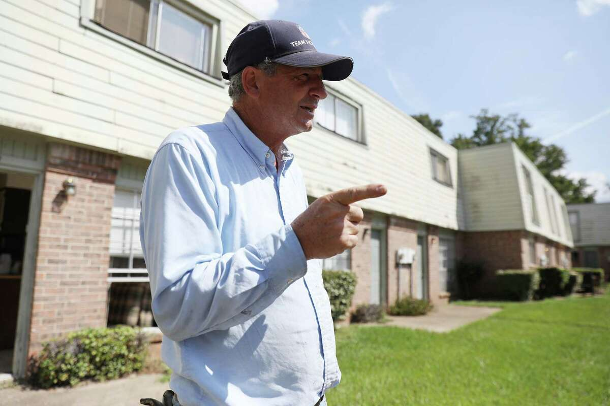 Bruce Johnson, owner of Travis Villas, talks about the damage to the building in Liberty.