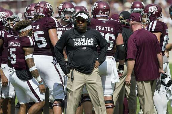 Texas A&M head coach Kevin Sumlin waits with his team during a timeout against Louisiana-Lafayette on Sept. 16, 2017, in College Station.