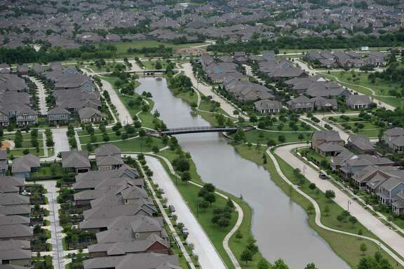 "A Cypress subdivision illustrates a county flood control rule on ""detention"" - a requirement that any development hold runoff in a basin and release it slowly so as to not increase flooding downstream."