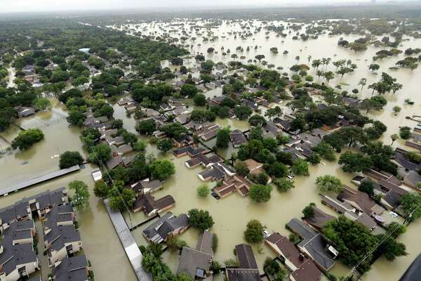 FILE - In this Tuesday, Aug. 29, 2017, file photo, water from Addicks Reservoir flows into neighborhoods as floodwaters from Harvey rise in Houston. Allstate expects $593 million in insurance losses for August due to Hurricane Harvey. That marks a spike from $181 million in July. The estimates do not include Hurricane Irma, which made landfall in September. (AP Photo/David J. Phillip, File)