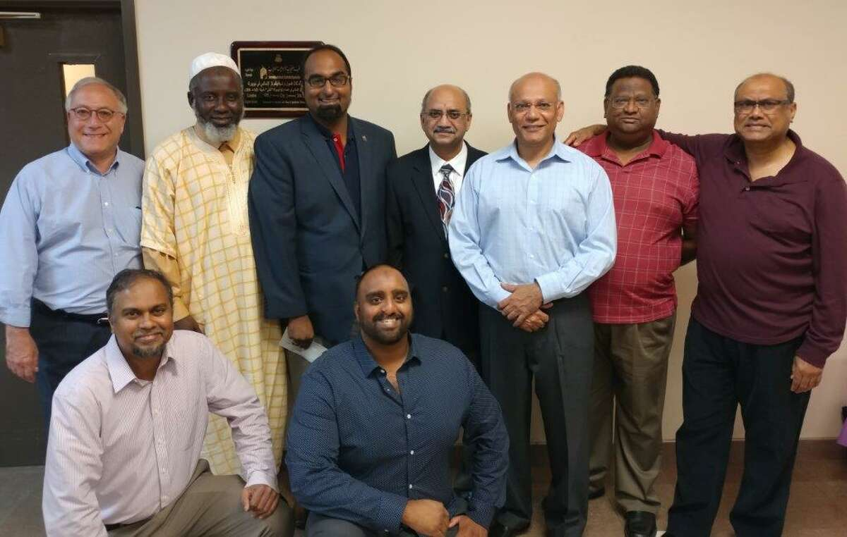 The Islamic Center of the Capital District donated $10,000 gift to victims of Harvey and Irma through the Red Cross and Islamic relief ($5,000 each) on Sept. 13. Pictured are: standing from left, Gary Striar of American Red Cross, Imam Abdul Rahman Yaki of the center, Suleman Sheikh of Islamic Relief USA, and Jamshaid Minhas, Tipu Nazeer, Imran Siddiqui and Zain Syed. Seated from left, Firasat Ali, Zubair Ahmed.