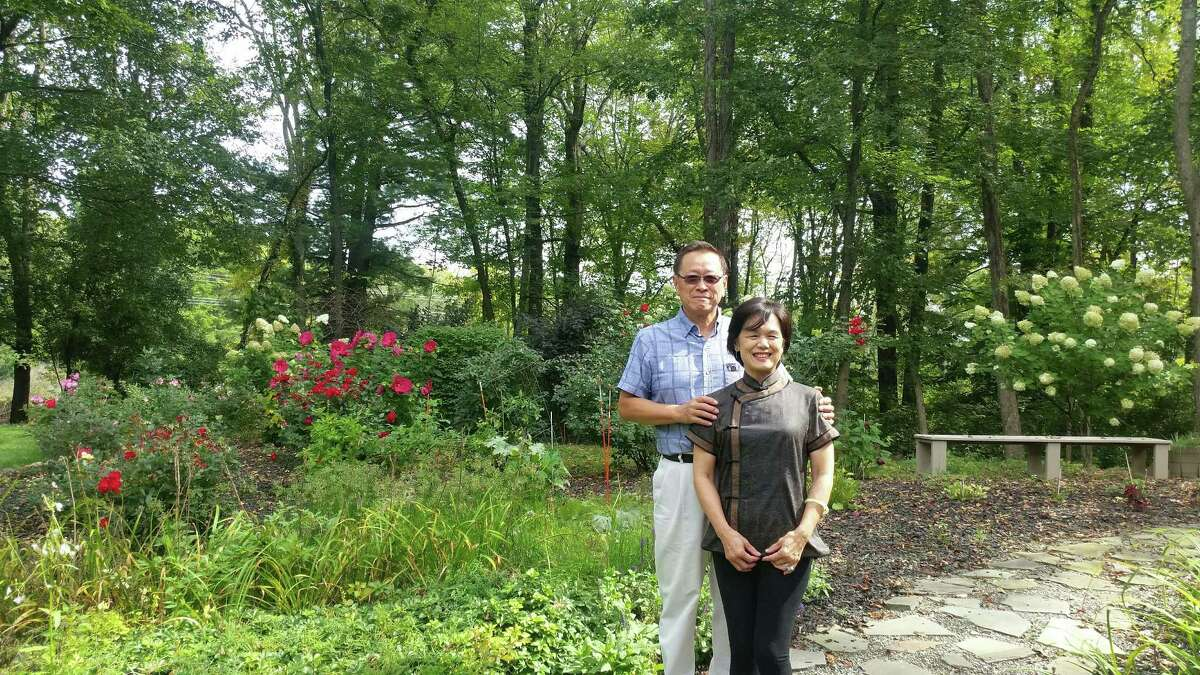 APAPA president HP Want and his wife Tingting stand in their garden. APAPA's Albany chapter, one of the biggest Asian associations in the region, donated 10,000 protective masks to the NAACP, Centro Civico and other organizations representing people of color last month. Wang reached out to the NAACP and Centro Civico to fight racism against all of their communities.