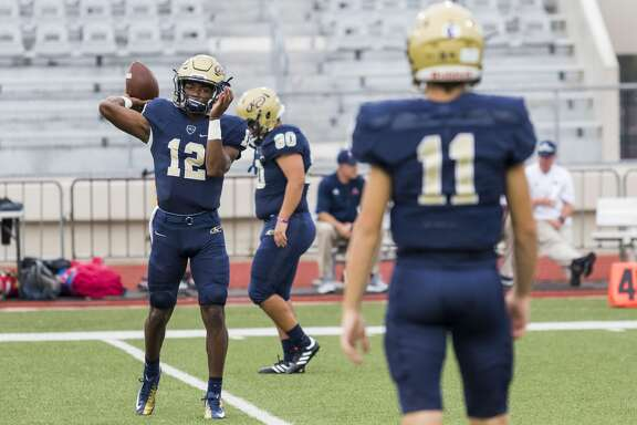 Klein Collins quarterbacks Kyler Williams (12) and Carter Rhyne (11) warm-up before a high school football game at Klein Memorial Stadium on Friday, Sept. 21, 2017, in Klein, Texas. (Joe Buvid / For the Chronicle)