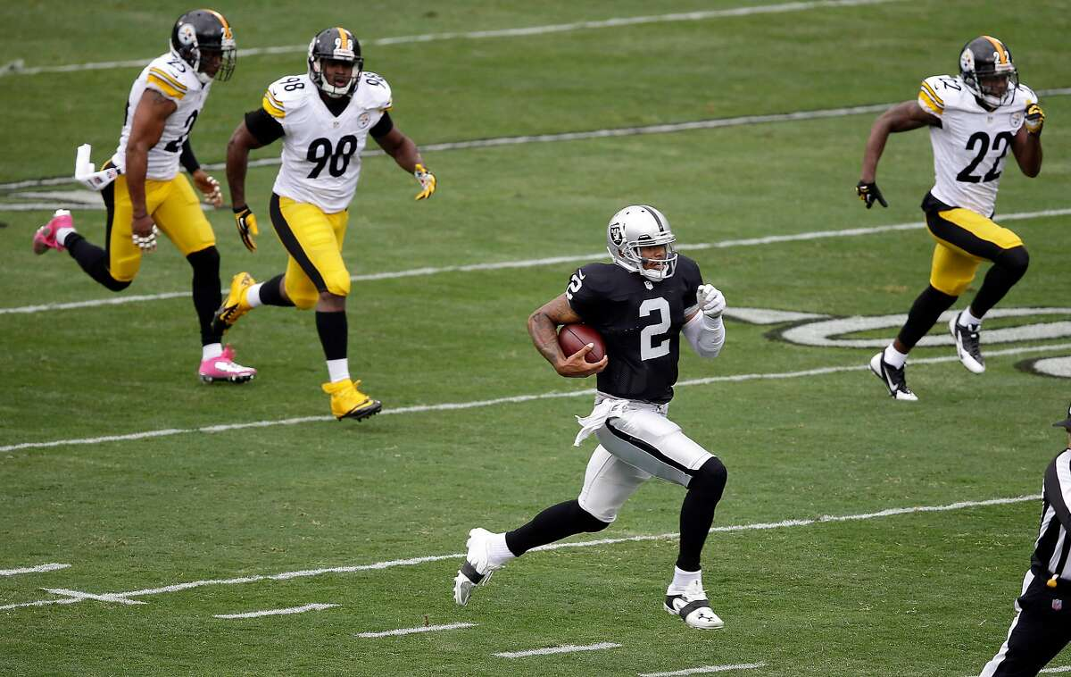 FILE - Oakland Raiders quarterback Terrelle Pryor (2) runs for a 93-yard touchdown past Pittsburgh Steelers free safety Ryan Clark, left, inside linebacker Vince Williams (98) and cornerback William Gay (22) during the first quarter of an NFL football game in Oakland, Calif., Sunday, Oct. 27, 2013.