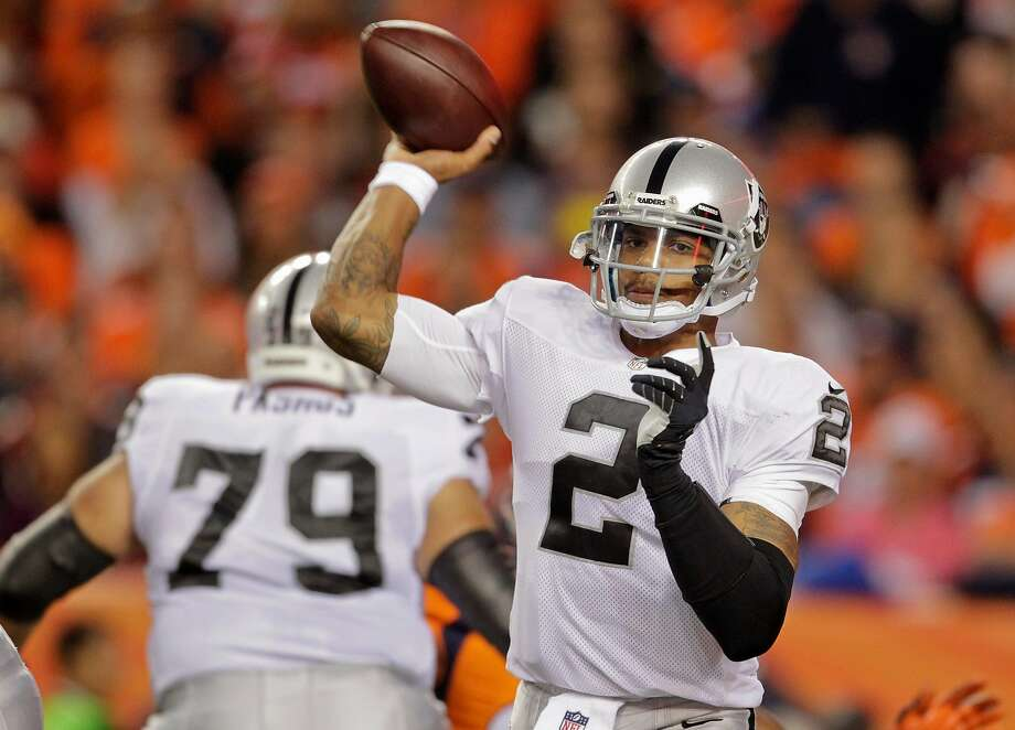 FILE - Oakland Raiders quarterback Terrelle Pryor (2) throws against the Denver Broncos in the second quarter of an NFL football game, Monday, Sept. 23, 2013, in Denver. Pryor was reportedly hurt in a stabbing at his Pittsburgh apartment Friday night. He underwent emergency surgery early Saturday morning. Photo: Joe Mahoney, Associated Press