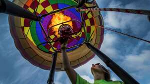 Balloon pilot Meg Quinn adds heat to her balloon during a demonstration at the Harrison Avenue Elementary School Thursday Sept. 21, 2017 in South Glens Falls, N.Y. The display of balloons was part of the 45th Annual Adirondack Balloon Festival which takes place this weekend in Glens Falls.   (Skip Dickstein/Times Union)