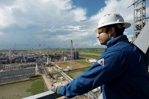 Raza Rizvi gazes out over the site of the massive DowDuPont ethane cracker during construction. The cracker, in Freeport, separates out ethane, a natural gas liquids component, providing the feedstock for ethylene, a building block of most plastics.
