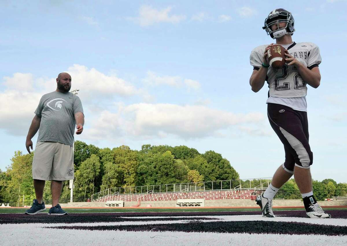 Burnt Hills-Ballston Lake assistant coach Jason LaPietro ,left, watches his son quarterback Darien LaPietro during practice on Tuesday, Sept. 19, 2017, in Burnt Hills, N.Y. (Hans Pennink / Special to the Times Union) ORG XMIT: HP115