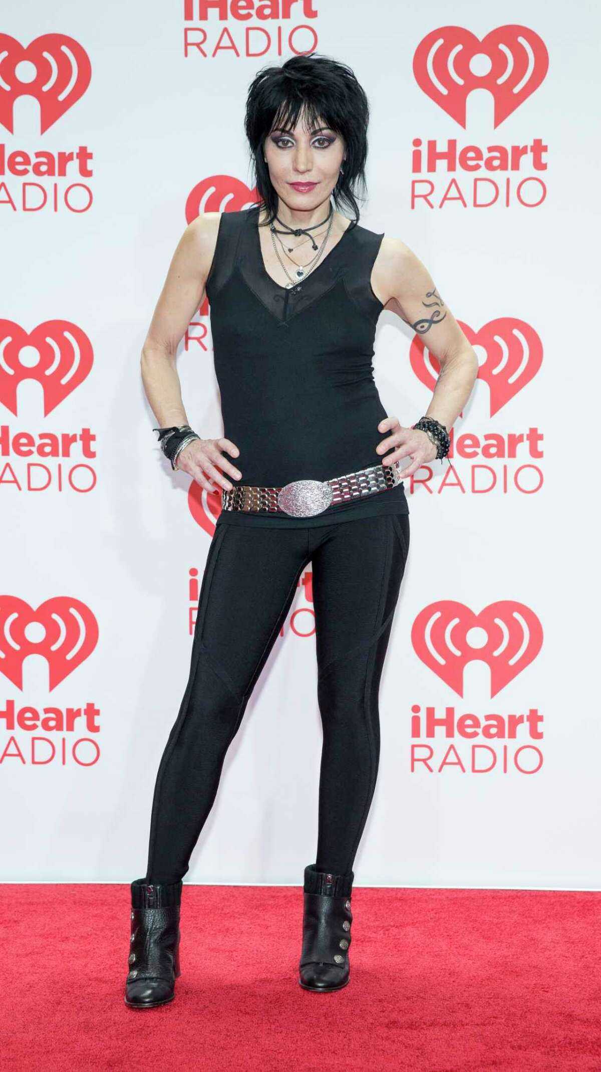 FILE - This Sept. 21, 2013 file photo shows musician Joan Jett at the iHeartRadio Music Festival in Las Vegas. Jett will be honored with the Golden God Award, given to an artist who ?