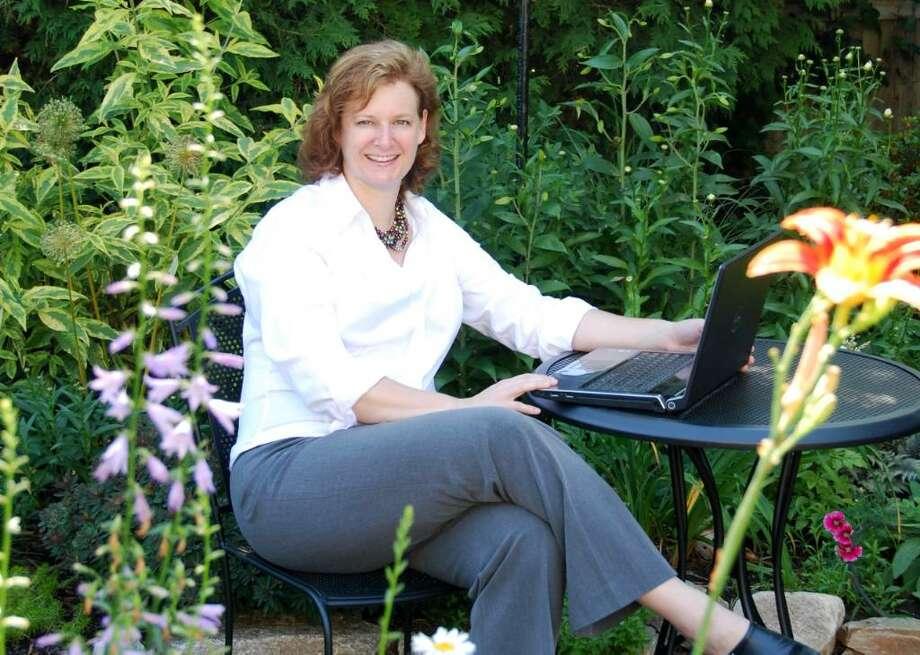 Monica Hemingway, founder of GardenPlansOnline, in her garden at her Stamford home. Photo: Contributed Photo / Stamford Advocate Contributed