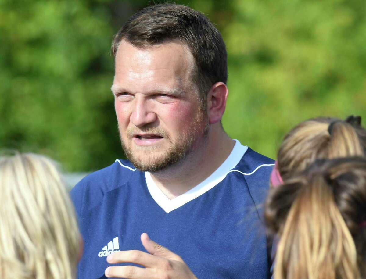 Holy Names Academy head coach Will Graham talks with his players before the start of a Section II Class B girls' high school soccer game against Schalmont in Rotterdam, N.Y., Thursday, Sept. 21, 2017. (Hans Pennink / Special to the Times Union) ORG XMIT: HP103