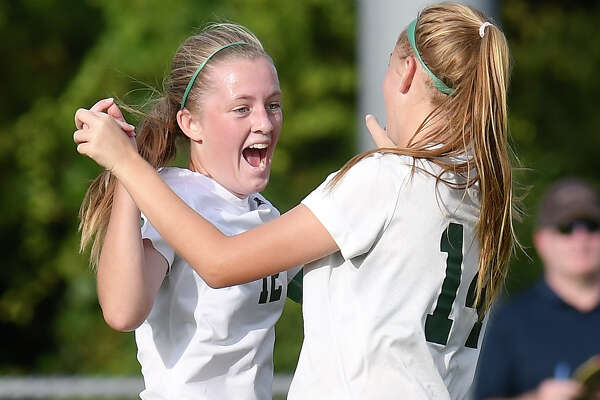 Schalmont's Molly Older (12) celebrates with teammate Kelly Sanders (14)  after scoring against Holy Names Academy during a Section II Class B girls' high school soccer game in Rotterdam, N.Y., Thursday, Sept. 21, 2017. (Hans Pennink / Special to the Times Union) ORG XMIT: HP113