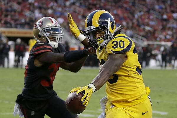 Los Angeles Rams running back Todd Gurley (30) runs for a touchdown against San Francisco 49ers defensive back Dontae Johnson (36) during the first half of an NFL football game in Santa Clara, Calif., Thursday, Sept. 21, 2017. (AP Photo/Ben Margot)