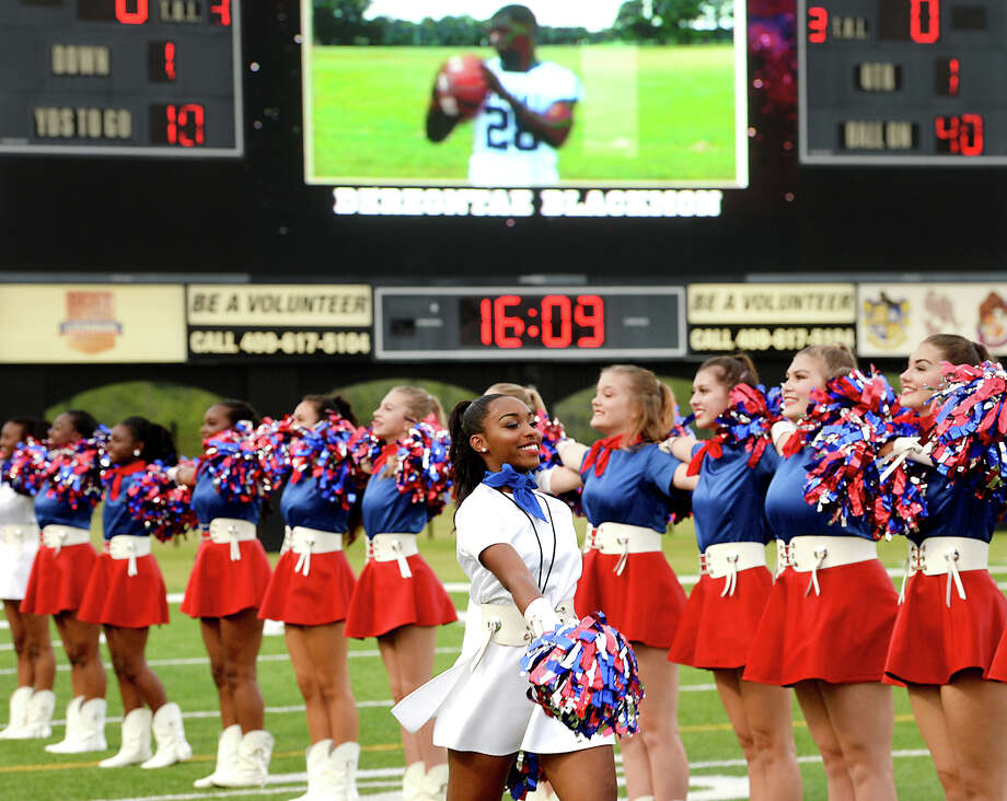 West Brook's dance squad take position on the field during their season opener at The Butch. Photo taken Thursday, September 21, 2017 Kim Brent/The Enterprise Photo: Kim Brent / BEN
