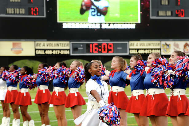 West Brook's dance squad take position on the field during their season opener at The Butch. Photo taken Thursday, September 21, 2017 Kim Brent/The Enterprise