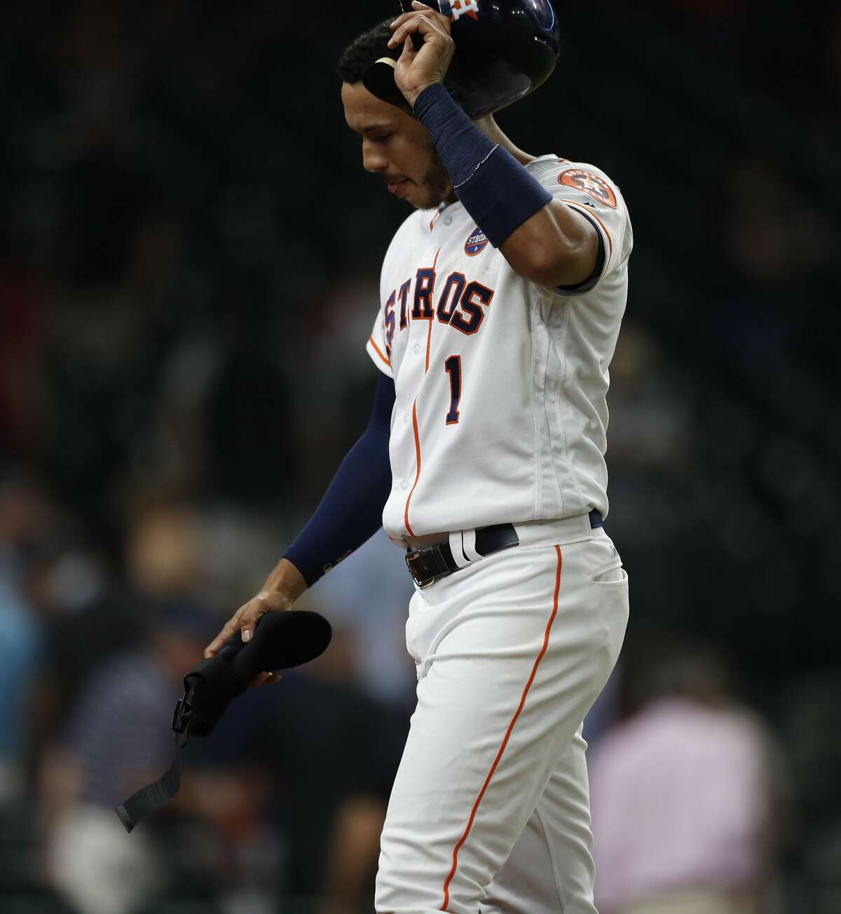 Houston Astros Carlos Correa (1) reacts as he walks back to the dugout after being left on base in the ninth inning of an MLB baseball game at Minute Maid Park, Thursday, Sept. 21, 2017, in Houston. ( Karen Warren / Houston Chronicle )