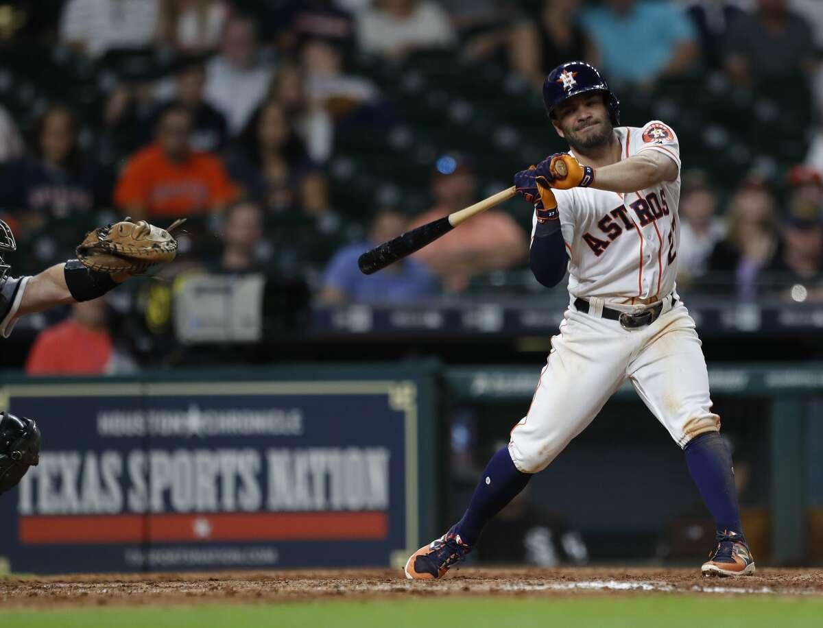 Houston Astros Jose Altuve (27) checks his swing during the ninth inning of an MLB baseball game at Minute Maid Park, Thursday, Sept. 21, 2017, in Houston. ( Karen Warren / Houston Chronicle )