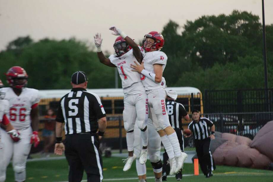 Dawson's Mason Pierce (1) and Dawson's Patrick Kramer (13) celebrate a touchdown against Dobie Thursday, Sep. 21 at Pasadena Veteran's Memorial Stadium. Photo: Kirk Sides / © 2017 Kirk Sides / Houston Chronicle