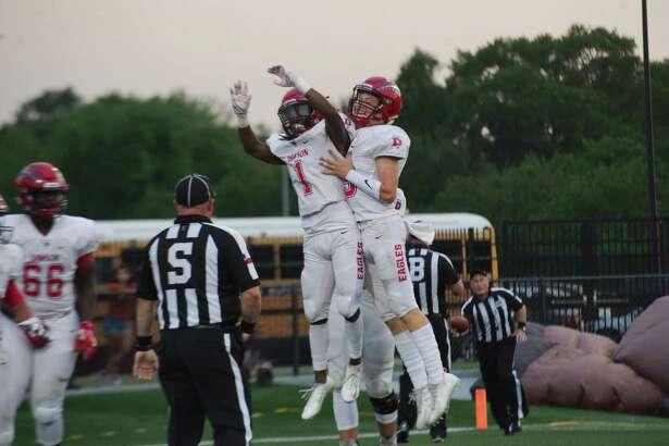 Dawson's Mason Pierce (1) and Dawson's Patrick Kramer (13) celebrate a touchdown against Dobie Thursday, Sep. 21 at Pasadena Veteran's Memorial Stadium.