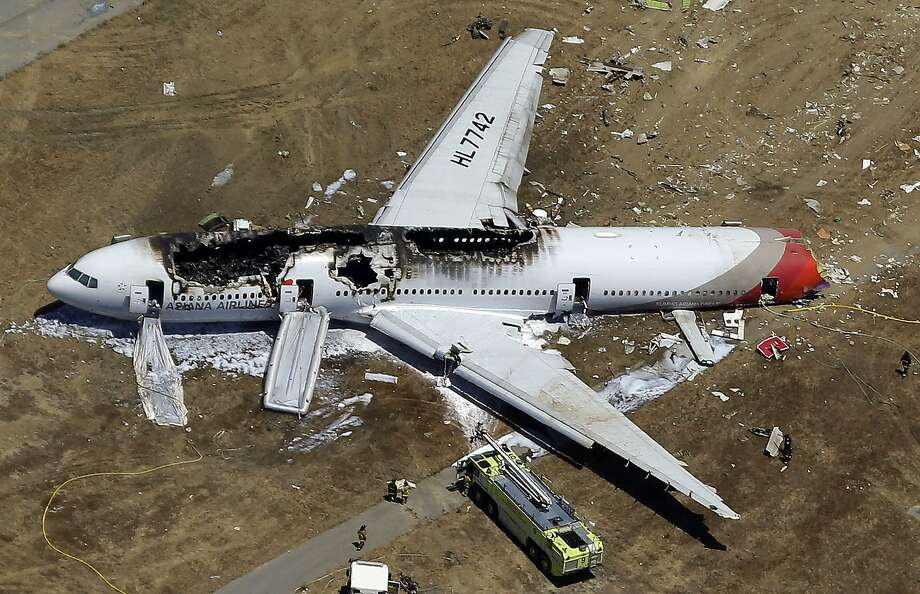 This Asiana plane struck the rocky seawall at the end of the tarmac, ripping the back of the aircraft off and hurling several passengers and crew members across the runway as the jet spun around and skidded to a stop. Photo: Marcio Jose Sanchez, Associated Press