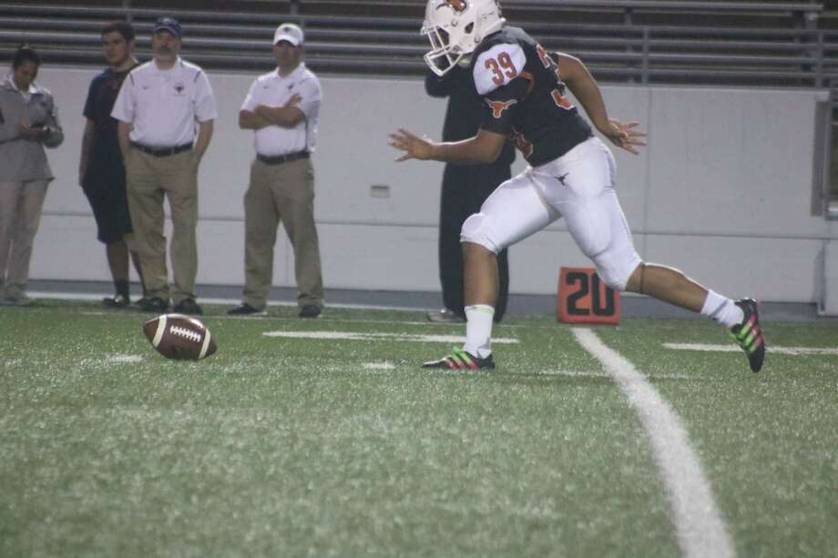 Dobie freshman punter Joshua Hernandez goes after the football, following a poor snap from center made Hernandez attempt to one-hop the snap. It didn't work, adding to Dobie's misery Thursday night. Photo: Robert Avery