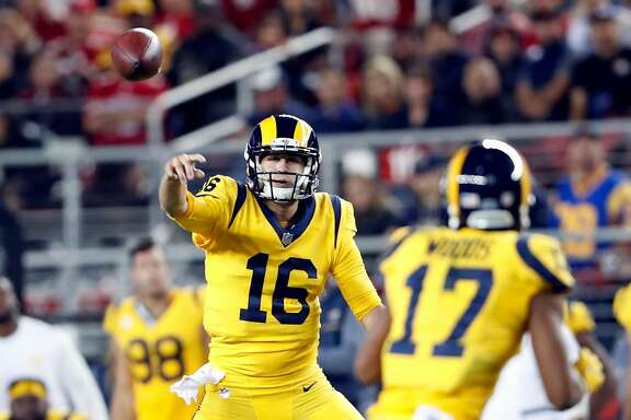 Los Angeles Rams' Jared Goff passes to Robert Woods in 3rd quarter during Rams' 41-39 win over San Francisco 49ers in NFL game at Levi's Stadium in Santa Clara, Calif., on Thursday, September 21, 2017.