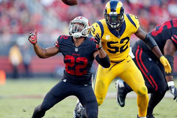 San Francisco 49ers' Matt Breida bobbles and eventually drops a pass in 1st quarter against Los Angeles Rams' Alec Ogletree during NFL game at Levi's Stadium in Santa Clara, Calif., on Thursday, September 21, 2017.