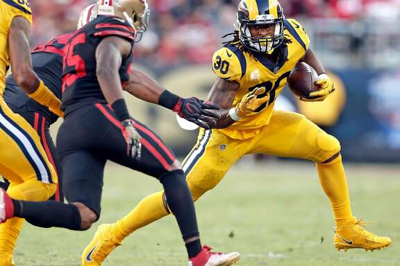 Los Angeles Rams' Todd Gurley rushes in 1st quarter against San Francisco 49ers during NFL game at Levi's Stadium in Santa Clara, Calif., on Thursday, September 21, 2017.