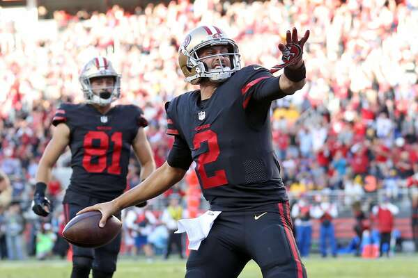 San Francisco 49ers' Brian Hoyer spikes the ball after his 1st quarter touchdown against Los Angeles Rams during NFL game at Levi's Stadium in Santa Clara, Calif., on Thursday, September 21, 2017.