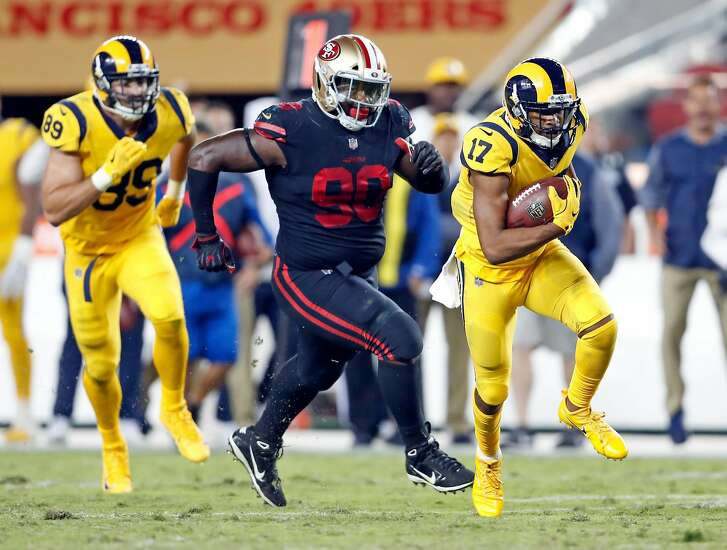 San Francisco 49ers' Solomon Thomas chases  Los Angeles Rams' Robert Woods in 3rd quarter during Rams' 41-39 win in NFL game at Levi's Stadium in Santa Clara, Calif., on Thursday, September 21, 2017.