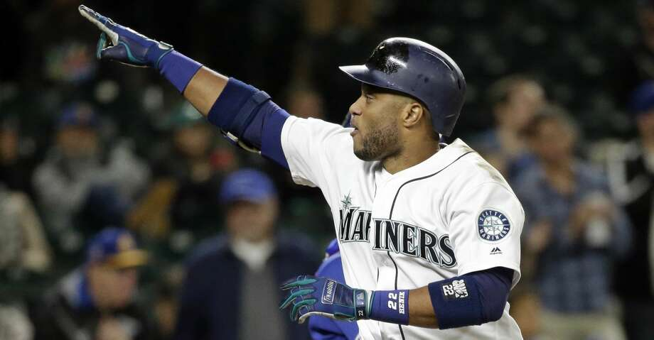 Seattle Mariners' Robinson Cano points to the stands as he crosses home on his solo home run against the Texas Rangers in the ninth inning of a baseball game Thursday, Sept. 21, 2017, in Seattle. The homer was the 300th of Cano's career. (AP Photo/Elaine Thompson) Photo: Elaine Thompson/Associated Press