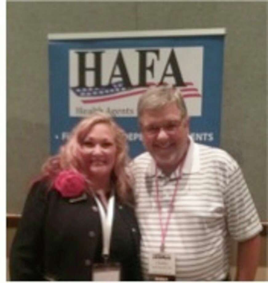 Ronnell Nolan, president and CEO HAFA, left, stands with Charles Blanchard, employee benefits specialist with Arbury Insurance Agency. (Photo provided)