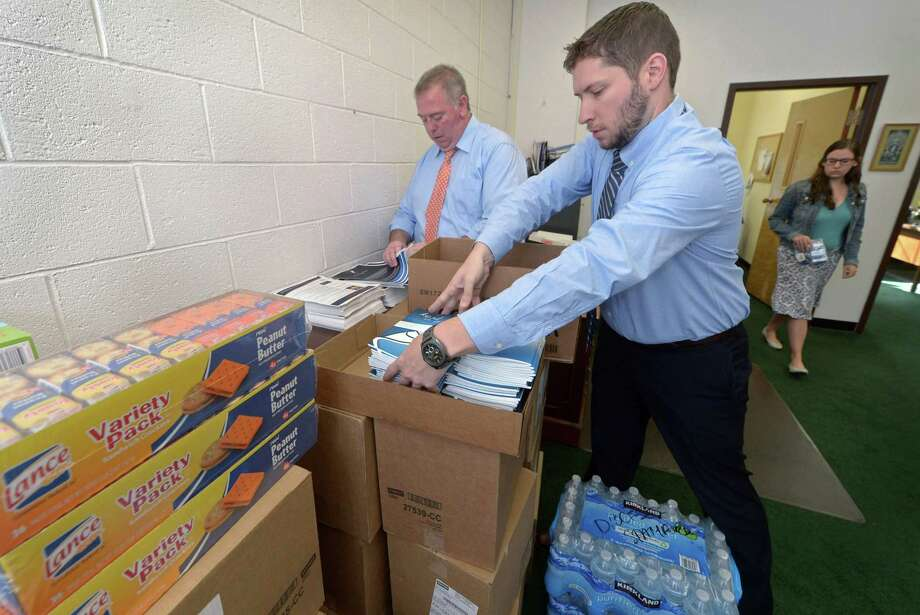 Leadership Institute Director Patrick Donovan and Youth and Young Adult Formation coordinator Evan Psencik pack rosaries and prayer books at The Catholic Center in Bridgeport on Thursday. Photo: Erik Trautmann / Hearst Connecticut Media / Norwalk Hour