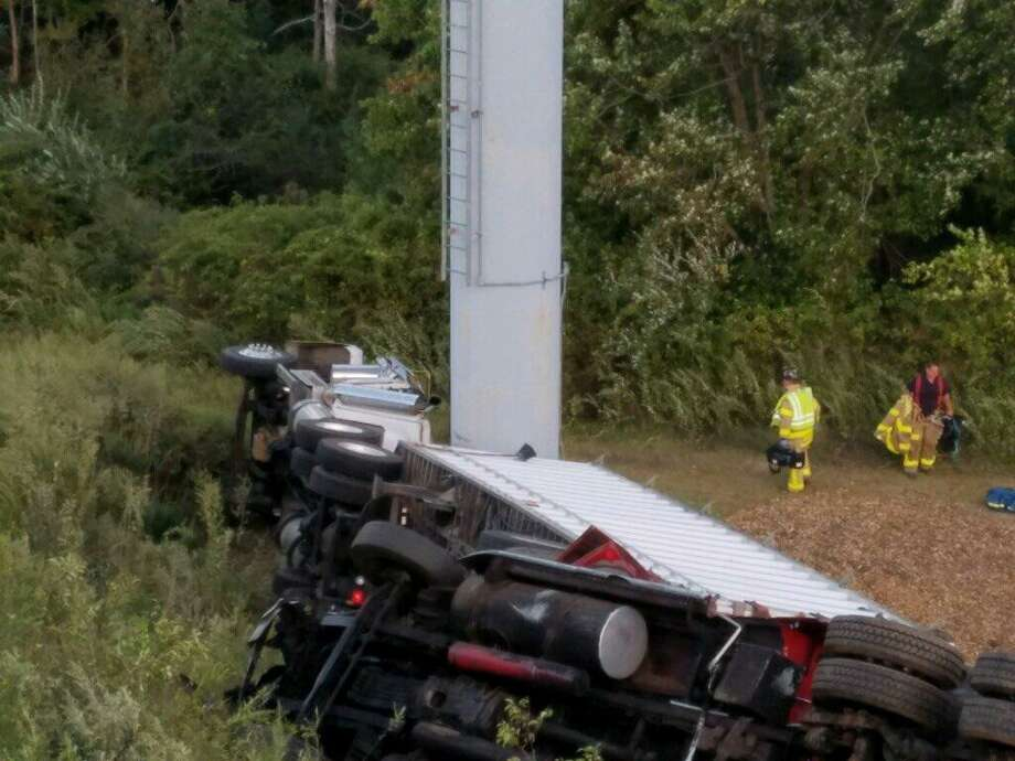 Two tractor-trailer trucks went down an embankment on I-95 in West Haven on Friday, Sept. 22, 2017. The accident that involved minor injuries shut down two southbound lanes, causing big delays in the area. Photo: Connecticut State Police Photo