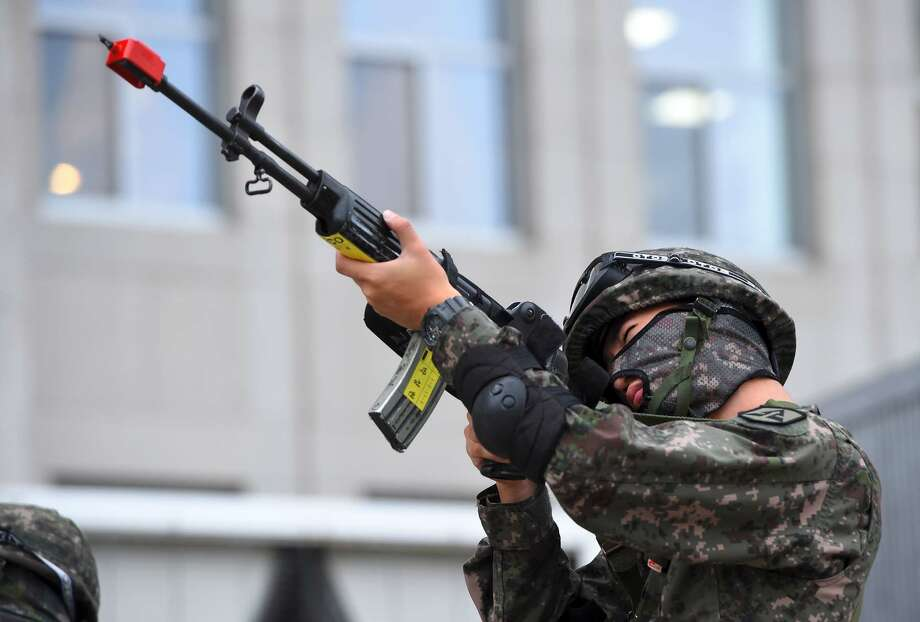 "A South Korean soldier aims his rifle during an anti-terror drill at the National Assembly in Seoul on August 23, 2017, on the sidelines of a South Korea-US joint military exercise. The anti-terror drill took place as tens of thousands of South Korean and US troops take part in the ""Ulchi Freedom Guardian"" joint military drills, a largely computer-simulated exercise that runs for two weeks in the South. / AFP PHOTO / JUNG Yeon-Je        (Photo credit should read JUNG YEON-JE/AFP/Getty Images) Photo: JUNG YEON-JE/AFP/Getty Images"