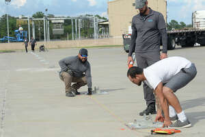 Work crews begin setting out the base plates and mapping out the site of a tent city which is being constructed to house displaced flood victims at the Port of Orange boat launch on Simmons Drive. The facility will accommodate some of the hundreds of evacuees who were sheltered in Dallas and other cities in the wake of Tropical Storm Harvey. Photo taken Thursday, September 21, 2017 Kim Brent/The Enterprise