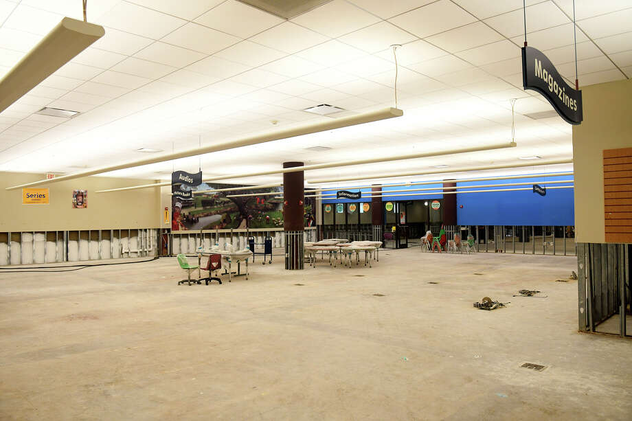 After four Harris County Public Library branches closed due to flooding due to Hurricane Harvey, only three will be opening their doors to the public in May. While the library system lost $4.4 million in books, furniture, electronics and materials for all four branches, repair costs for the Barbara Bush, Katherine Tyra and Kingwood branches will total $3.55 million. The repair costs for the Barbara Bush branch in Spring, above, will be $1.3 million after the entire first floor of the two-story building flooded. Photo: Jerry Baker, Freelance / Freelance