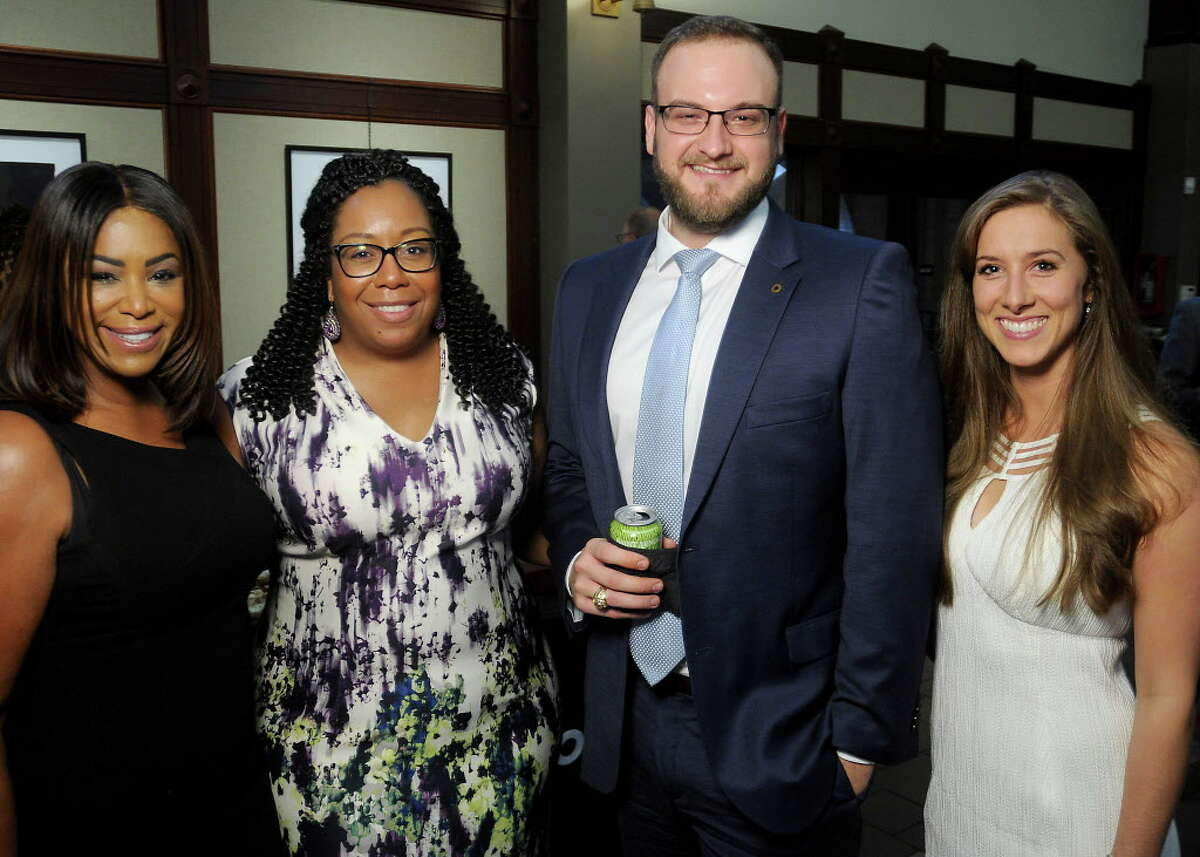 From left: Deborah Duncan, Trisha Bradley, Jordan Becker and Kelli McBee at the Come to the Table at The Beacon event downtown Thursday Sept. 21, 2017.